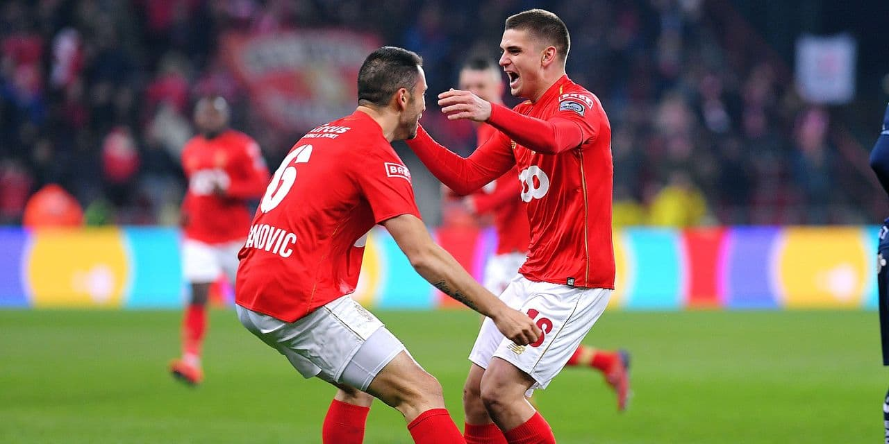 Standard's Milos Kosanovic and Standard's Razvan Marin celebrate after scoring during a soccer game between Standard de Liege and Royal Excel Mouscron, Saturday 02 March 2019 in Liege, on the 28th day of the 'Jupiler Pro League' Belgian soccer championship season 2018-2019. BELGA PHOTO LUC CLAESSEN