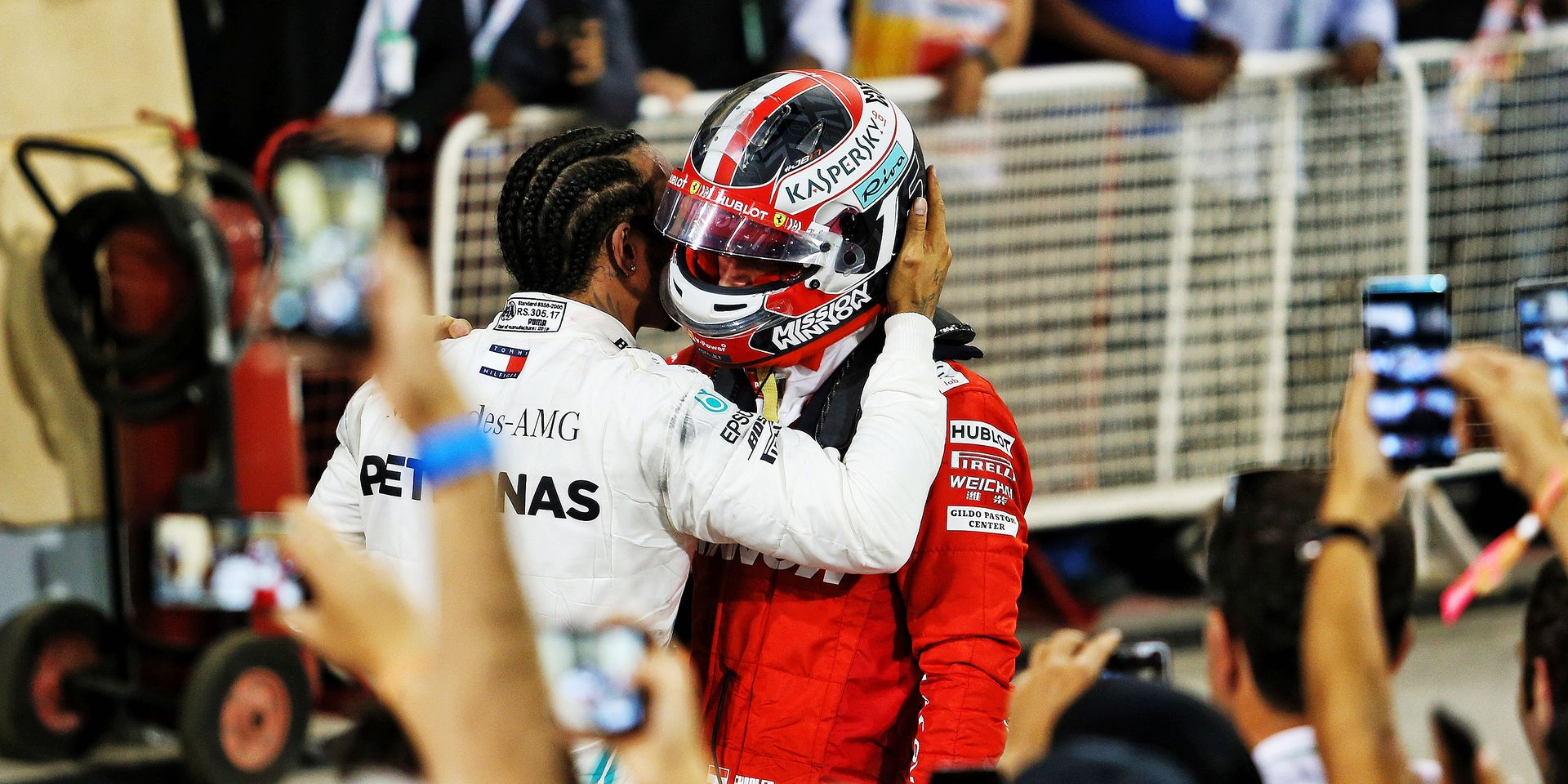 (L to R): Race winner Lewis Hamilton (GBR) Mercedes AMG F1 commiserates with third placed Charles Leclerc (MON) Ferrari in parc ferme. 31.03.2019. Formula 1 World Championship, Rd 2, Bahrain Grand Prix, Sakhir, Bahrain, Race Day. - www.xpbimages.com, EMail: requests@xpbimages.com - copy of publication required for printed pictures. Every used picture is fee-liable. © Copyright: Moy / XPB Images