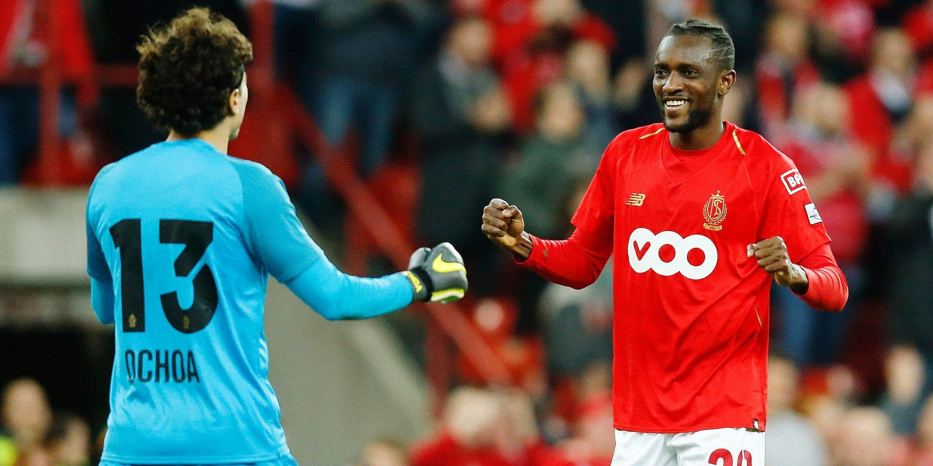 Standard's goalkeeper Guillermo Ochoa and Standard's Merveille Bope Bokadi celebrate after winning a soccer game between Standard de Liege and Royal Antwerp FC, Friday 29 March 2019 in Liege, on day 1 (out of 10) of the Play-off 1 of the 'Jupiler Pro League' Belgian soccer championship. BELGA PHOTO BRUNO FAHY
