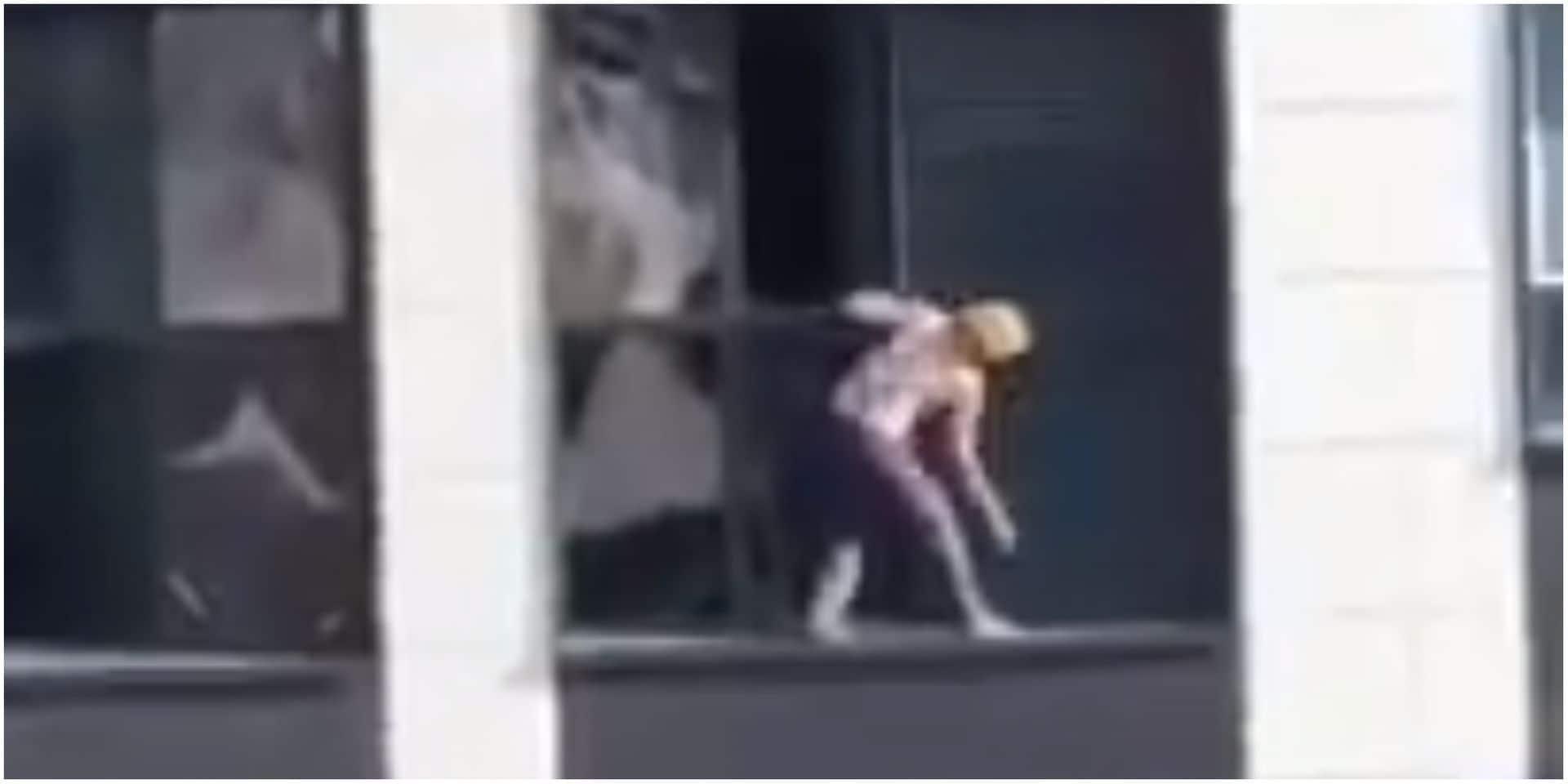 Sans aucune protection, une femme lave ses vitres... au 18e étage d'un immeuble ! (VIDEO)