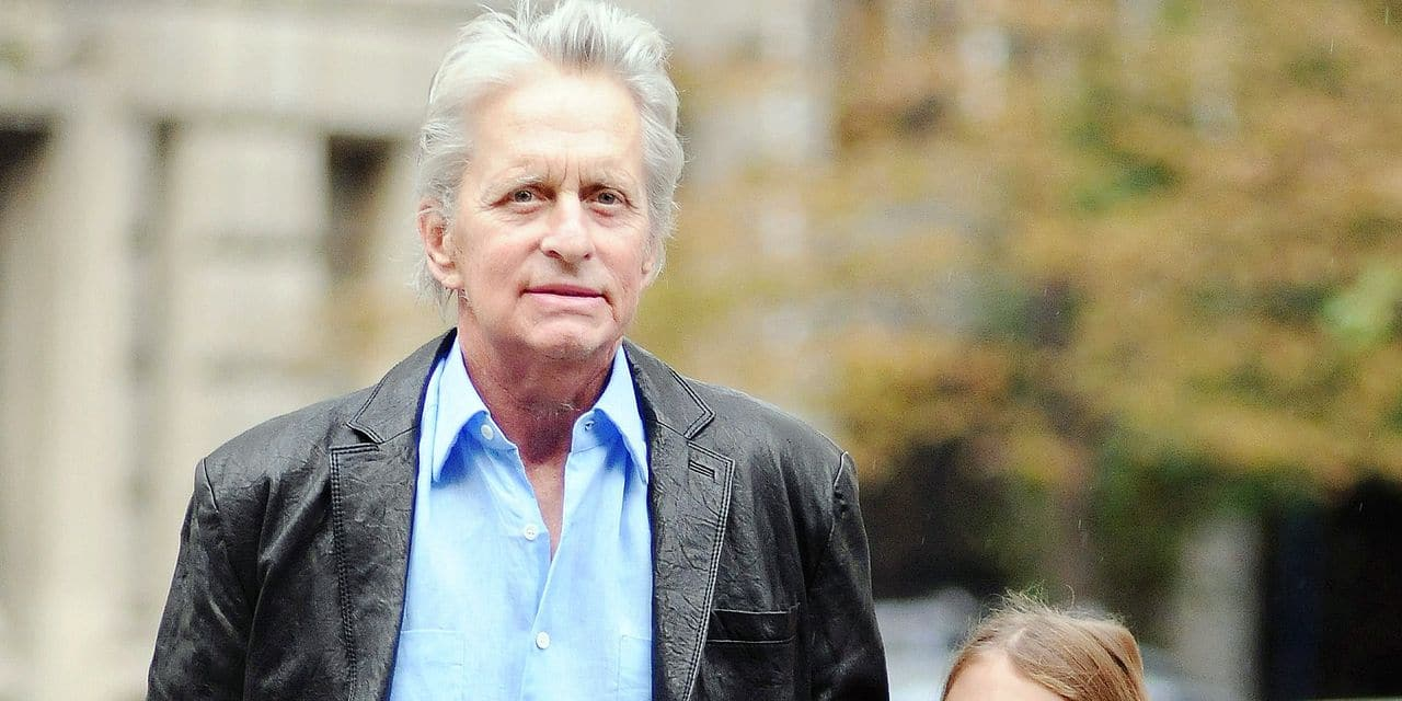 Michael Douglas Looks Happy On The School Run