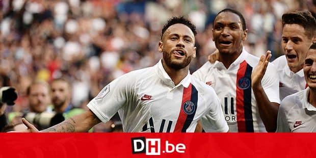 Paris Saint-Germain's Brazilian forward Neymar celebrates after scoring a goal during the French L1 football match between Paris Saint-Germain (PSG) and Racing Club de Strasbourg Alsace (RCS) on September 14, 2019 at the Parc des Princes stadium in Paris. (Photo by Martin BUREAU / AFP)