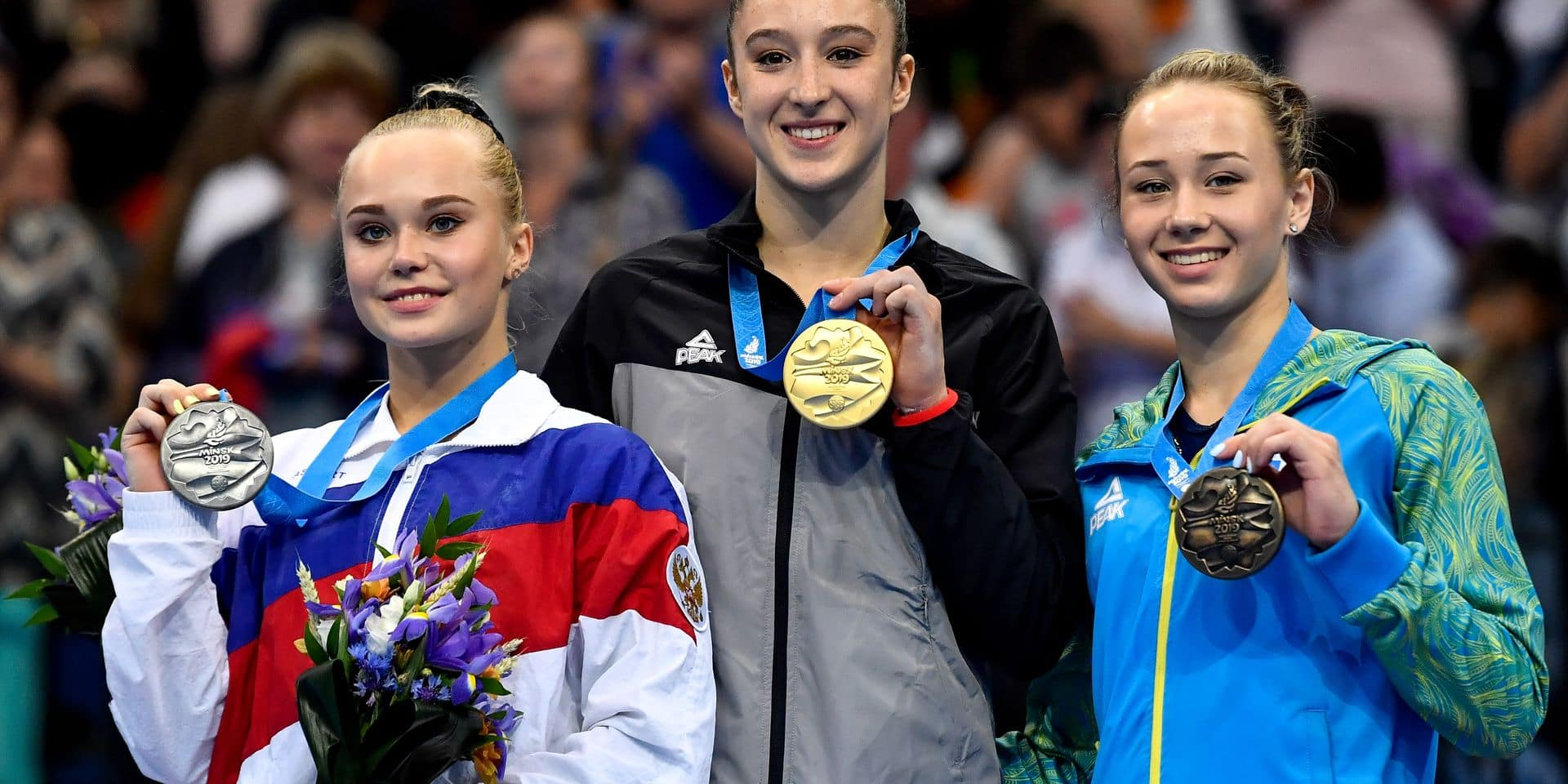 Russian Angelina Melnikova, winner of the silver medal, Belgian gymnast Nina Derwael, winner of the golden medal and Ukraine's Diana Varinska, winner of the bronze medal pictured on the podium after the beam final of the women's artistic gymnastics event at the European Games in Minsk, Belarus, Sunday 30 June 2019. The second edition of the 'European Games' takes place from 21 to 30 June in Minsk, Belarus. Belgium will present 51 athletes from 11 sports. BELGA PHOTO DIRK WAEM