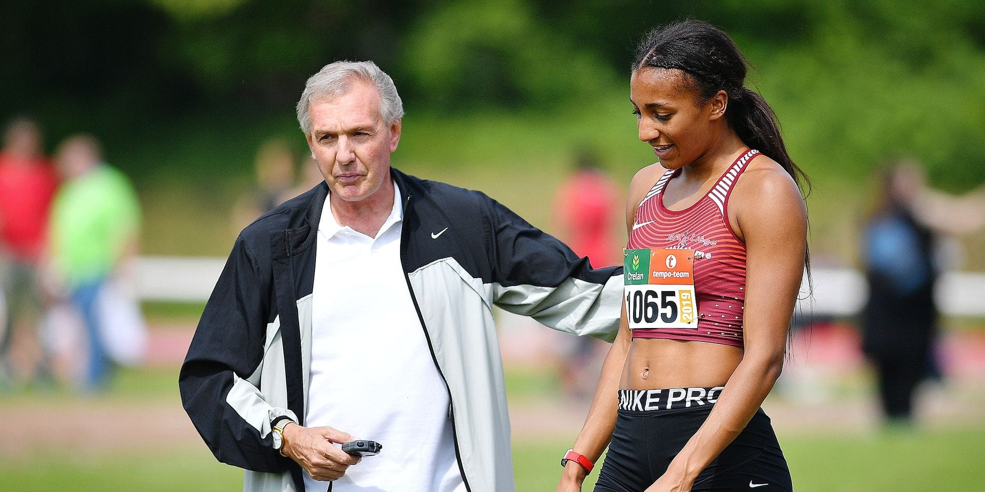 Belgian athlete Nafissatou 'Nafi' Thiam and her coach Roger Lespagnard pictured after the 200m race at the RUSTA Intercercles women's athletics meeting, Saturday 18 May 2019 in Gaurain-Ramecroix, Tournai. BELGA PHOTO DAVID STOCKMAN