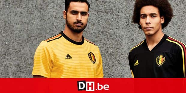 This handout picture, distributed on Tuesday 20 March 2018 by Ketchum show Belgium's Nacer Chadli and Belgium's Axel Witsel posing in shirts of the Belgian national soccer team Red Devils, which will be used at the 2018 World Cup in Russia. BELGA PHOTO HANDOUT KETCHUM