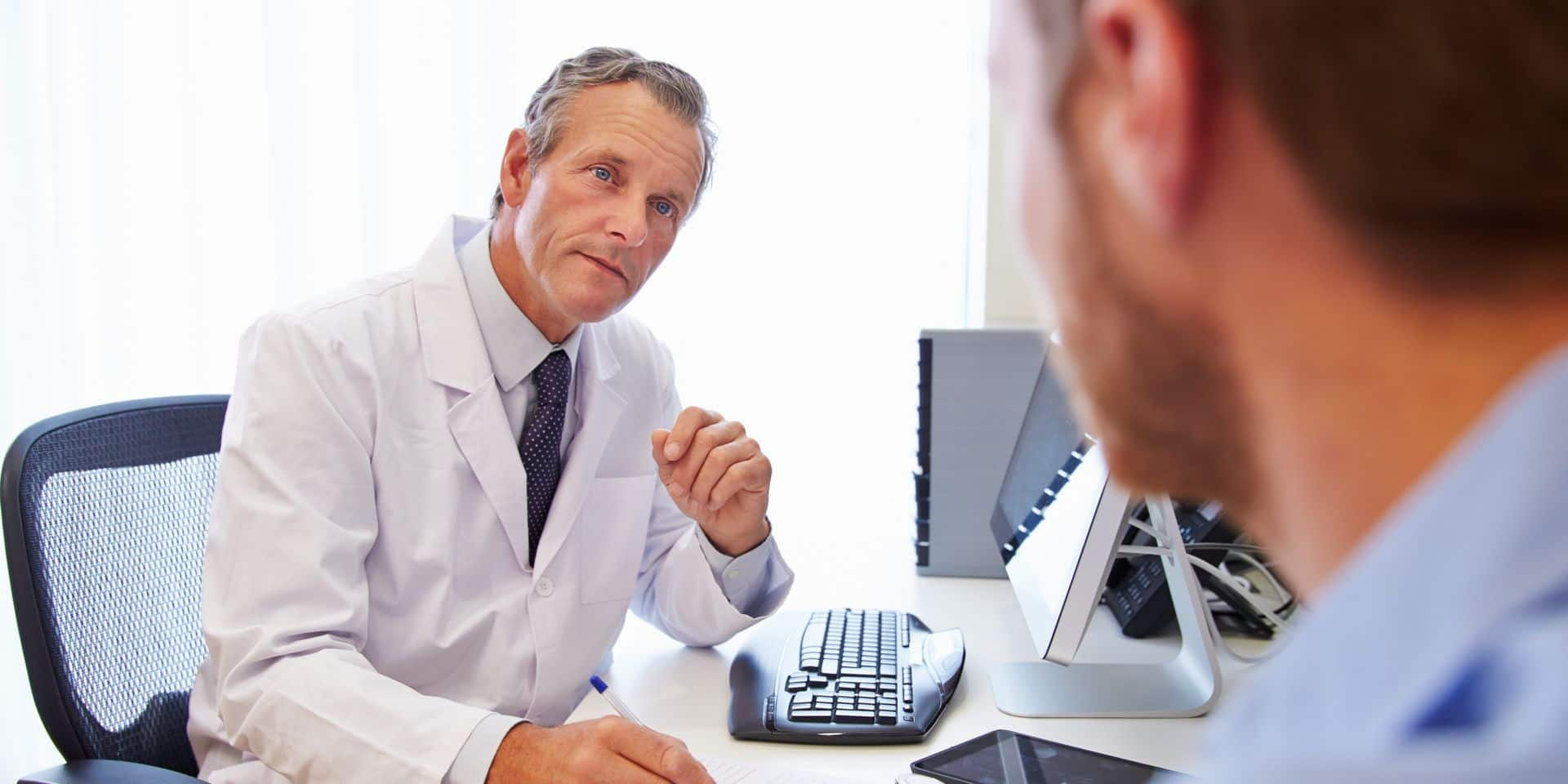 Male,Patient,Having,Consultation,With,Doctor,In,Office