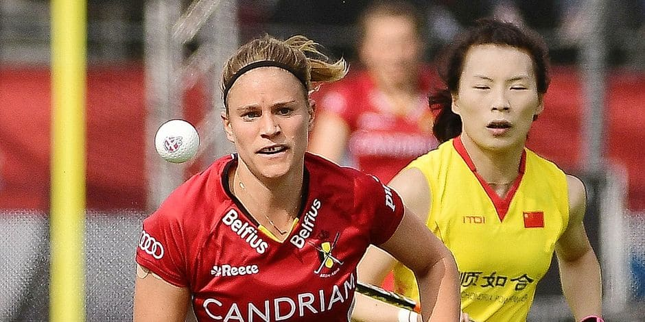 Belgium's Alix Gerniers and China's Guo Qiu fight for the ball during a hockey game between Belgium national team Red Panthers and China, Sunday 07 April 2019 in Brussels, game 5/16 of the FIH Pro League women's competition. BELGA PHOTO LAURIE DIEFFEMBACQ