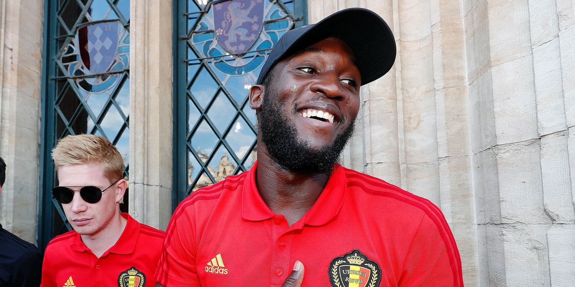 Belgium's Kevin De Bruyne and Belgium's Romelu Lukaku celebrate at the Grand-Place - Grote Markt in Brussels city center, as Belgian national soccer team Red Devils come to celebrate with supporters at the balcony of the city hall after reaching the semi-finals and winning the bronze medal at the 2018 Soccer World Cup in Russia, Sunday 15 July 2018. BELGA PHOTO POOL YVES HERMAN
