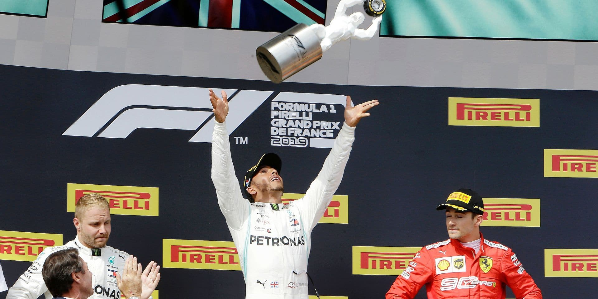 Mercedes driver Lewis Hamilton, center, of Britain, celebrates on the podium after winning the French Formula One Grand Prix with second placed Mercedes driver Valtteri Bottas, left, of Finland and third placed Ferrari driver Charles Leclerc of Monaco, at the Paul Ricard racetrack, in Le Castellet, southern France, Sunday, June 23, 2019. (AP Photo/Claude Paris)