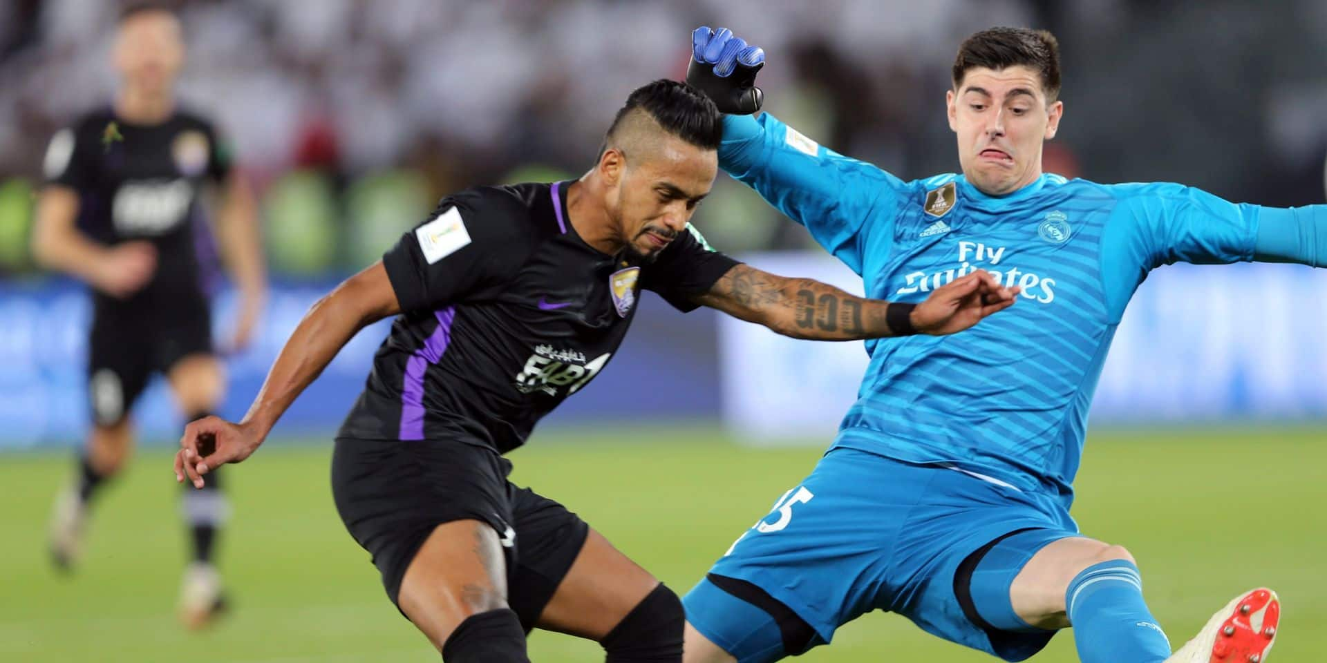 Emirates's Al Ain Caio challenges Real Madrid's goalkeeper Thibaut Courtois, right, during the Club World Cup final soccer match between Real Madrid and Al Ain at Zayed Sport City in Abu Dhabi, United Arab Emirates, Saturday, Dec. 22, 2018. (AP Photo/Kamran Jebreili)
